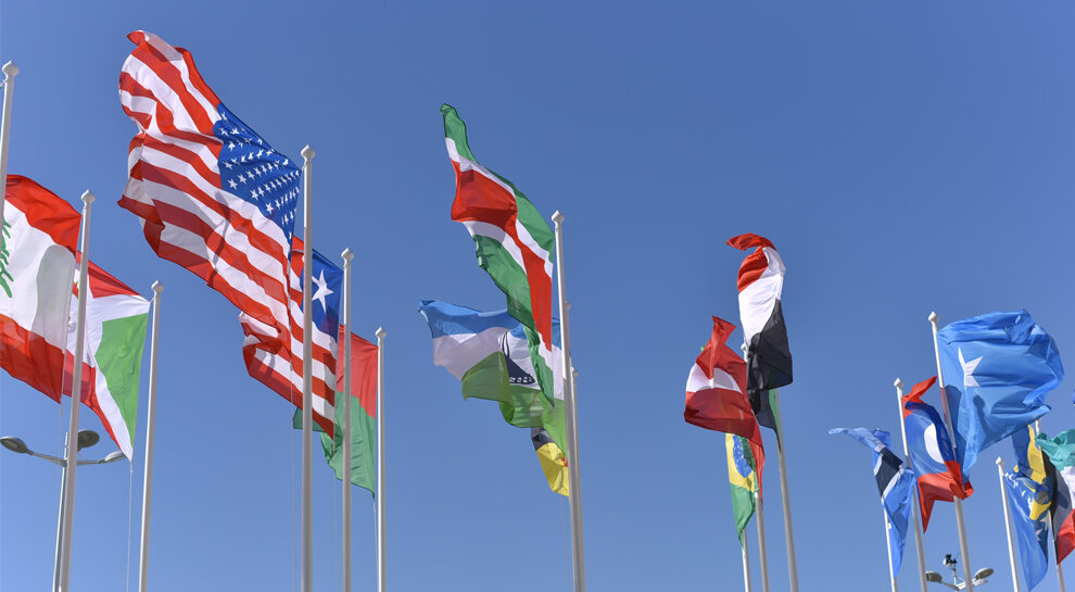 international flags symbolizing international money transfer and cross-border payments
