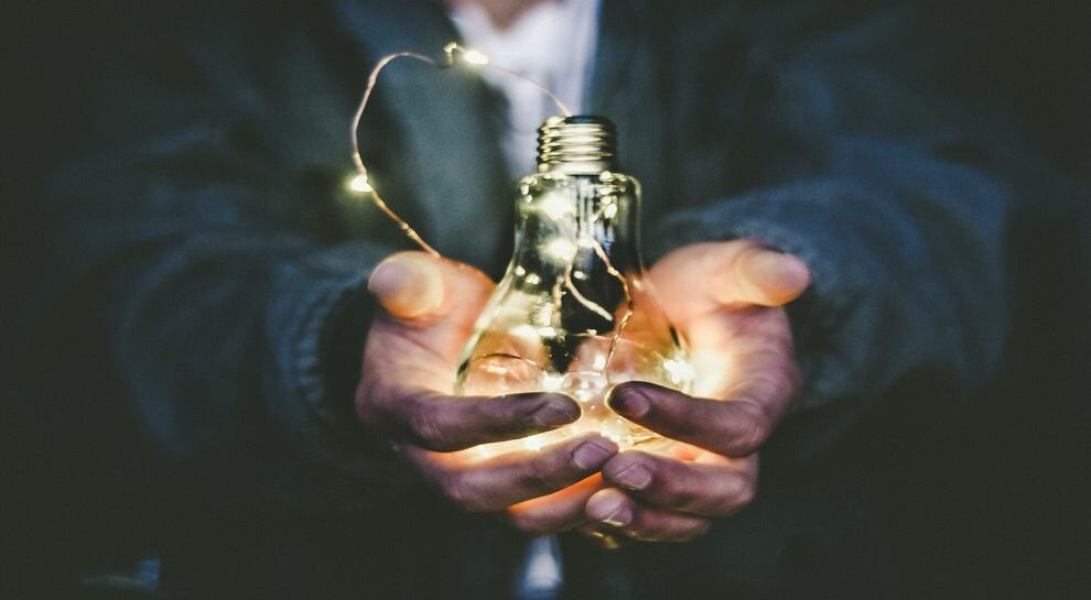 person holding lightbulb symbolizing mobile payments boom