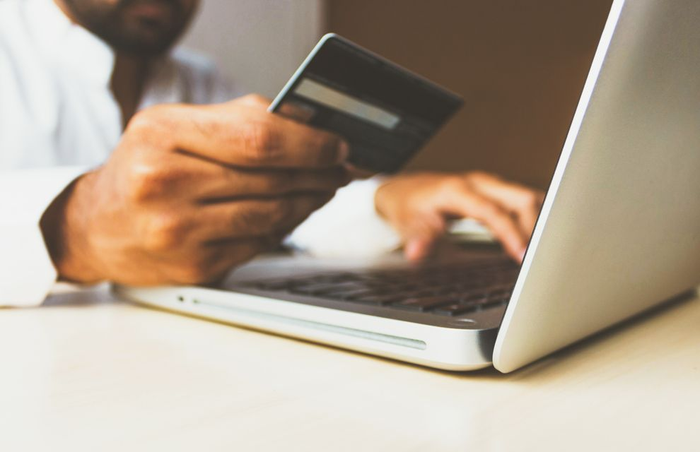 paying online with card symbolizing the shift to e-commerce