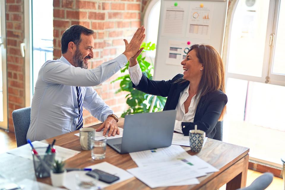 employees highfive symbolizing employee engagement