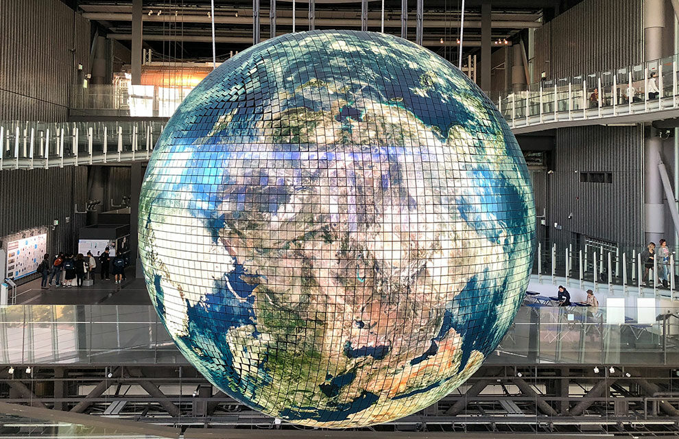 giant globe hanging in a corporate building symbolizing ecommerce leadership