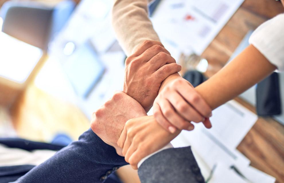 holding hands symbolizing community