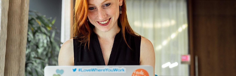 woman working on laptop symbolizing knowledge hub