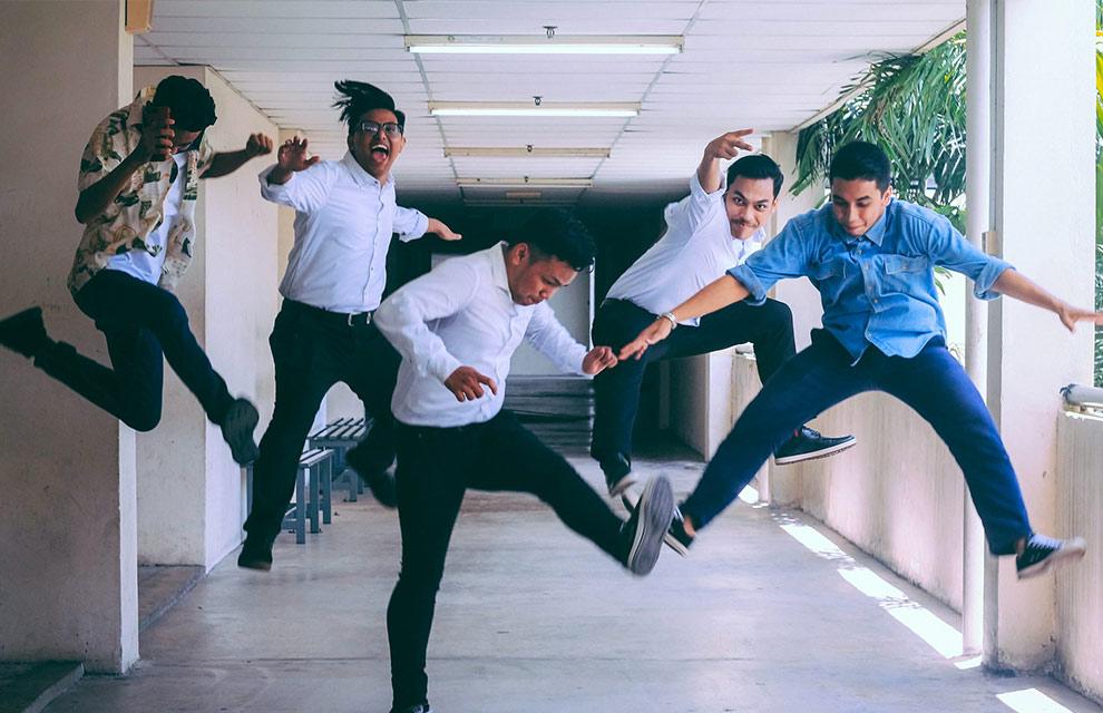 people jumping symbolizing team motivation