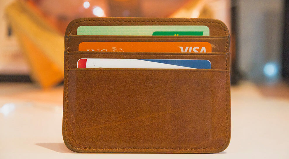 debit and credit cards in a wallet symbolizing card-acquiring process for PSPs